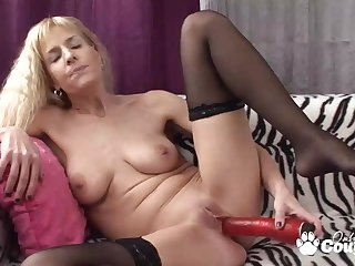 Natura busty Adeline Barb take off her clothes and wanking close by giant red vibrator