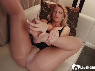 In order to get him hard, she used her pretty hands on a sex toy