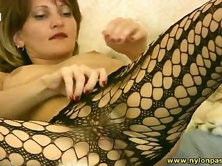 Lustful slut is playing with yourself in the hottest pantyhose solo action